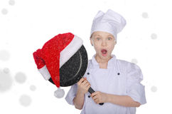 Surprised girl, frying pan and Santa hat with snow Stock Images