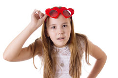 Surprised girl with funny glasses heart-shaped Royalty Free Stock Photo