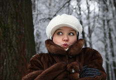 The surprised girl in a fur coat Royalty Free Stock Photos