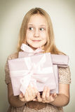 Surprised girl with gift box Royalty Free Stock Photography