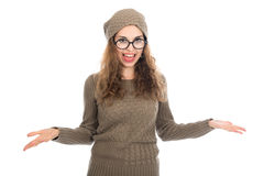 Surprised girl in glasses with arms spread apart. Royalty Free Stock Photography
