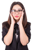 Surprised girl in glasses with hands on cheeks Stock Photo