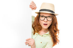 Surprised girl in glasses and a hat Stock Image