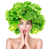 Surprised girl with green Lettuce hairstyle. Dieting concept Royalty Free Stock Photography