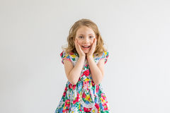 Surprised girl. With hands up isolated on white Royalty Free Stock Image