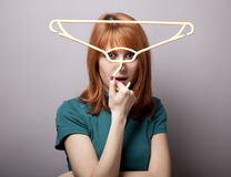 Surprised girl with hanger Stock Photo