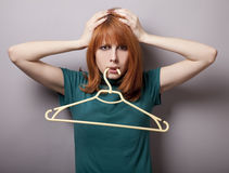 Surprised girl with hanger Stock Photography