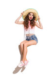 Surprised Girl in Hat Sitting on a Banner Stock Photography