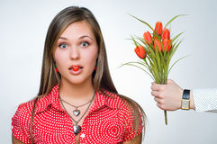 Surprised girl with heart-shaped candy Stock Photo