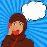 Surprised girl in hijab with telephone handset on comic book background Stock Image