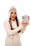 Surprised girl holding christmas present royalty free stock photos