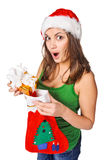 Surprised girl holding a Christmas sock. Royalty Free Stock Image