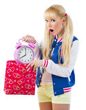 Surprised girl holding clock Royalty Free Stock Images