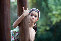 Surprised girl. Holds her hand over mouth Royalty Free Stock Photography