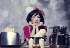 Surprised girl with at kitchen. Royalty Free Stock Photography