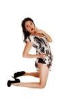 Surprised girl kneeling. Royalty Free Stock Image