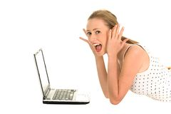 Surprised girl with laptop Stock Images