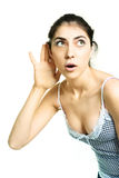 Surprised girl listening to something Stock Photo