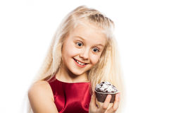 Surprised girl looking at cake Stock Image