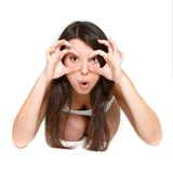 Surprised girl looking through imaginary binocular Stock Photos