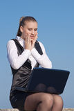 Surprised girl looking at notebook Royalty Free Stock Photo