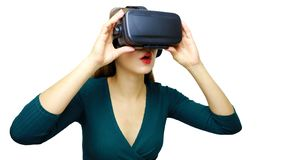 Surprised girl looking at Virtual Reality Glasses. Virtual reality, vr box. Studio, indoors.  royalty free stock photography