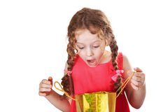 Surprised girl looks at a shopping bags Royalty Free Stock Photography