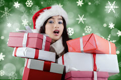 Surprised girl with many christmas present boxes Stock Images