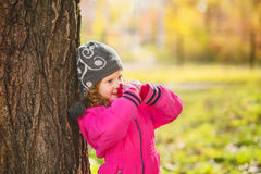 Surprised girl near a large tree. Ecological concept. Instagram Royalty Free Stock Image