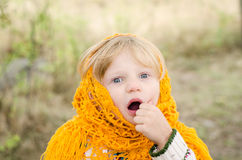 Surprised girl  in orange pelerine in autumn season Royalty Free Stock Photos