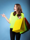 Surprised girl with paper colorful shopping bag Royalty Free Stock Photos