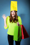Surprised girl paper shopping bag on head. Sales. Royalty Free Stock Images
