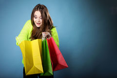 Surprised girl with paper shopping bag. Sales. Stock Photography