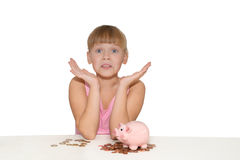 Surprised girl with piggy bank isolated Stock Image