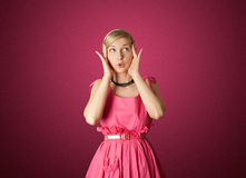 Surprised girl in pink Stock Photos