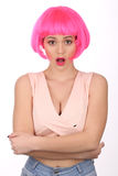 Surprised girl with pink hair. Close up. White background Royalty Free Stock Image