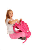 Surprised girl pointing on backpack. Stock Photography