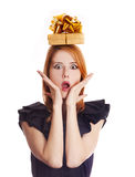 Surprised girl with present box over head Stock Images