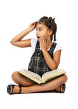 Surprised girl reading a book royalty free stock photo