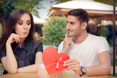 Surprised Girl Receiving Heart Shaped Gift from her Boyfriend Stock Image