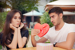 Surprised Girl Receiving Heart Shaped Gift from her Boyfriend Stock Photography