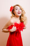 Surprised girl in red dress with flower barrette Royalty Free Stock Photo