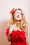 Surprised girl in red dress with flower barrette Stock Images