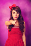 Surprised girl in red dress Royalty Free Stock Photos