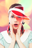 Surprised girl in red sun visor Stock Photo