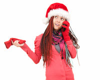 Surprised girl in santa claus hat on the phone Royalty Free Stock Photos