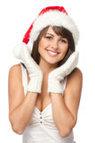 Surprised girl in Santa hat. Yong woman wearing Santa hat holding hands to face in surprise over white background royalty free stock images