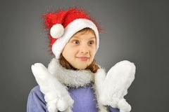 Surprised girl with  santa hat Stock Image