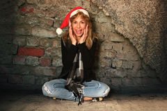 Surprised Girl in a Santa Hat. Royalty Free Stock Photography