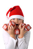 Surprised girl in Santa red hat isolated on white Royalty Free Stock Photo